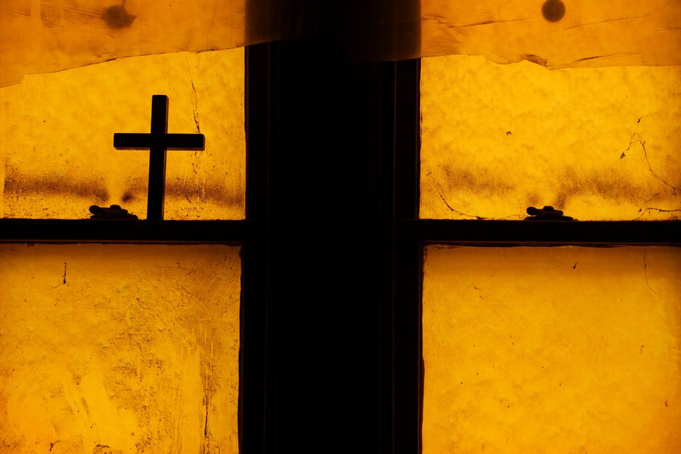 A cross rested on a windowsill during an open house.