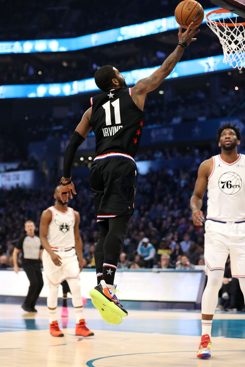 Kyrie Irving finishes off a layup during the first half of the NBA All-Star Game.