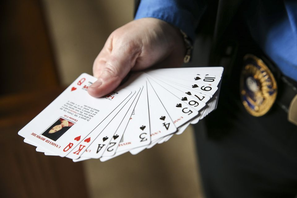 A deck of playing cards that each feature an unsolved murder case in Rhode Island