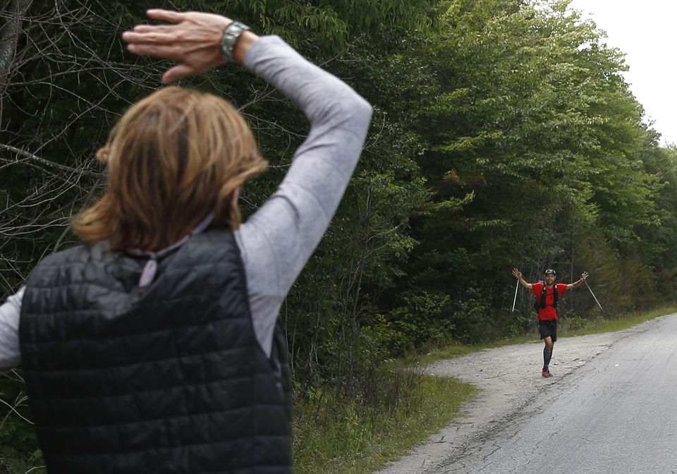 McConaughy's mother, Mary Ann McConaughy, waved as he emerged from the wilderness at Abol Bridge in Millinocket, Maine.