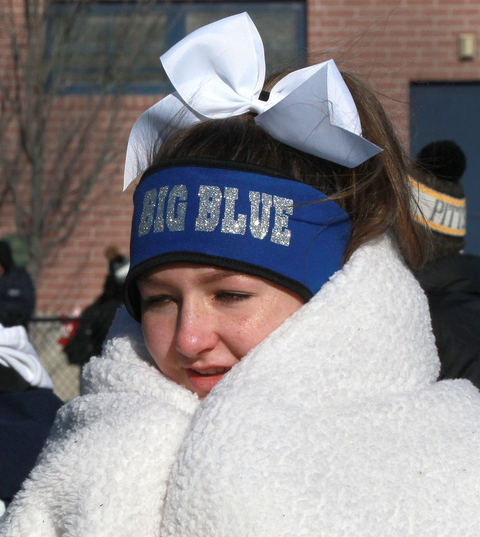 Swampscott High School cheerleader Tabitha Randell was bundled up before the game against Marblehead.