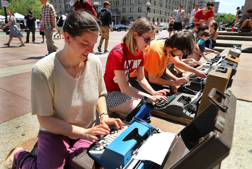"Zoe Sherman took part in the ""Write-In"" in Copley Square Friday. The event, inspired by the sit-ins of the civil rights movement, started slowly enough before the sight of some kneeling before eight typewriters lured others."