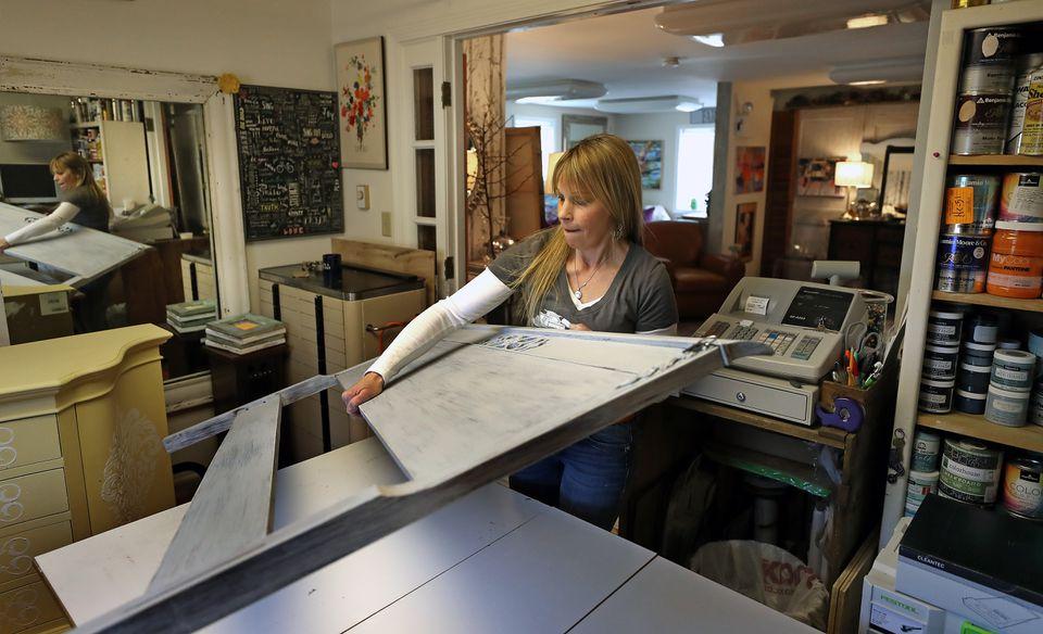 Pam Leonard works on a headboard in her studio space at B Cheeky.