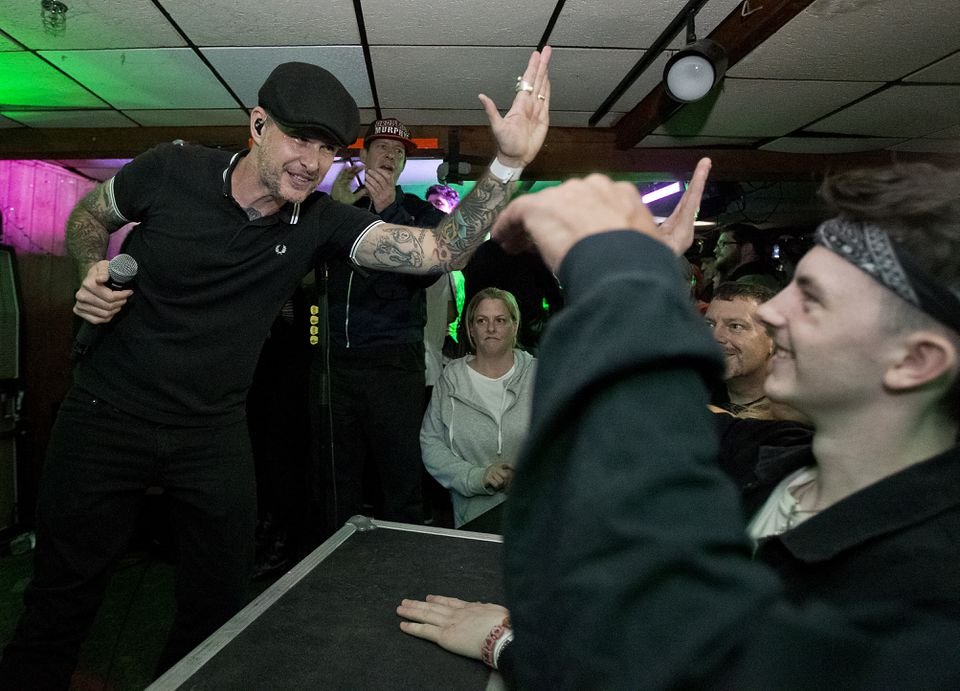 Al Barr of the Dropkick Murphys high-fived fans at the Beachcomber.