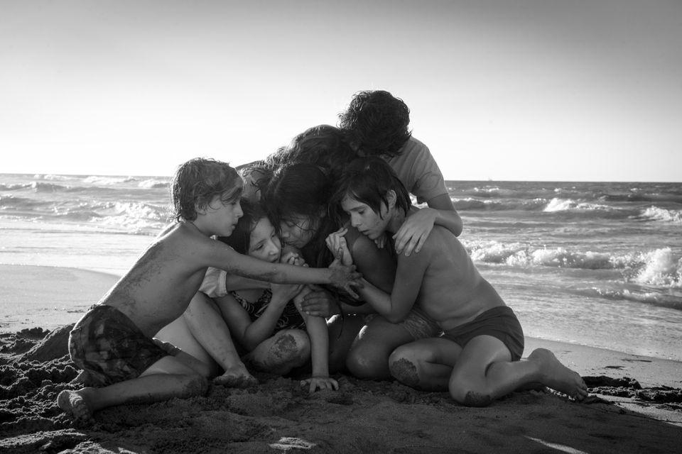"Marco Graf, Daniela Demesa, Yalitza Aparicio, Marina de Tavira, Diego Cortina Autrey, and Carlos Peralta Jacobson in Alfonso Cuarón's ""Roma."""