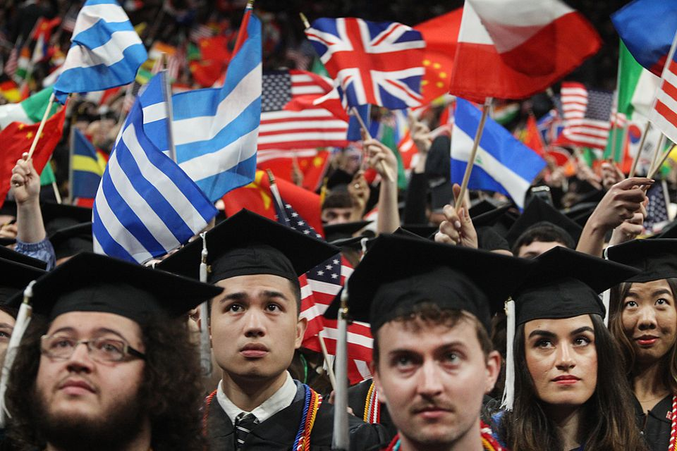 Graduates waved flags at the Northeastern University graduation at TD Garden on May 3.
