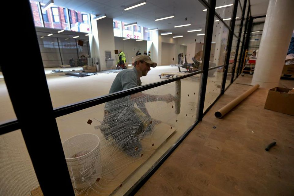 The glass in the gym is washed as workers attend to last-minute details before the first nine floors open next week. The property has a health club with cardio equipment, on-demand fitness classes, free weights, and more.