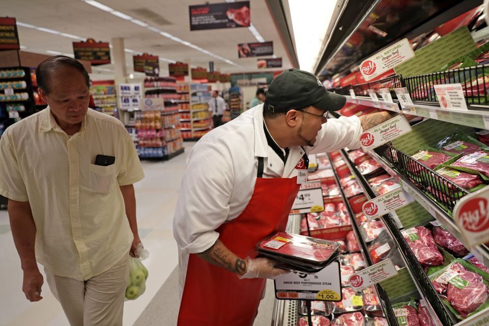 Edwin Crespo manned the meat counter at the Big Y on Hancock Street in Quincy. The company kept former Hannaford employees on the payroll when it took over.
