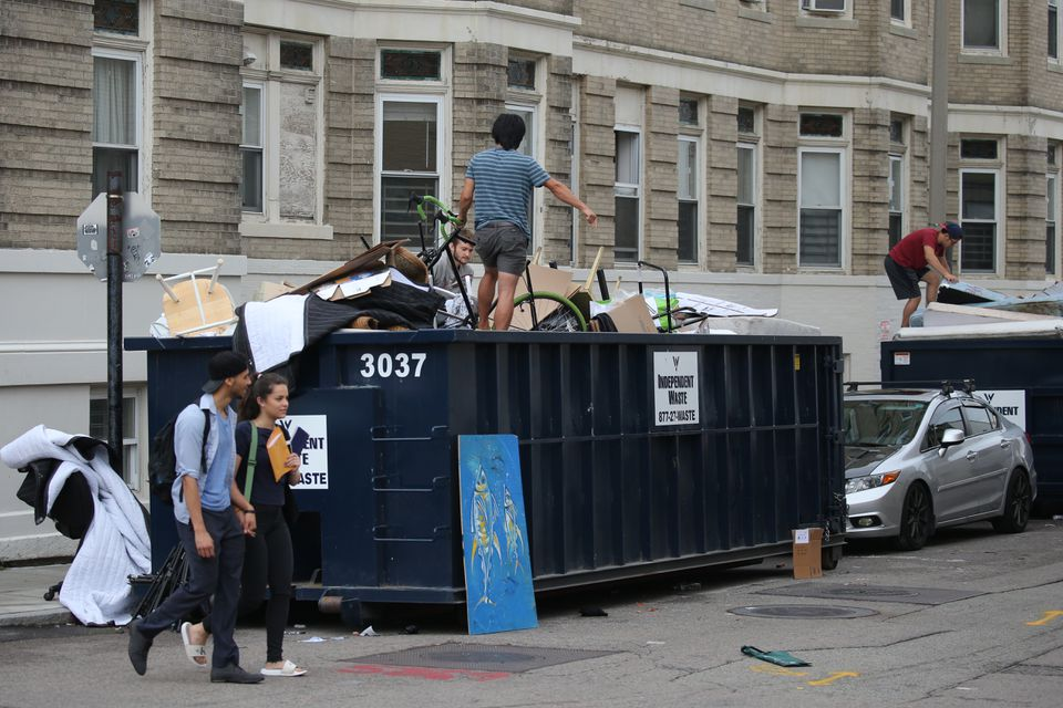 People went through dumpsters looking for treasure near Brighton Avenue.