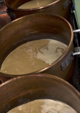 Copper pots with cajeta.