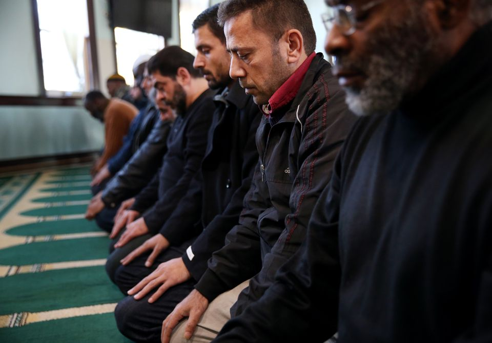 Syrian refugees prayed last week at the Islamic Society of Greater Worcester in Worcester. Voters are deeply split over Governor Charlie Baker's resistance to accepting Syrian refugees here, according to a Suffolk University poll.