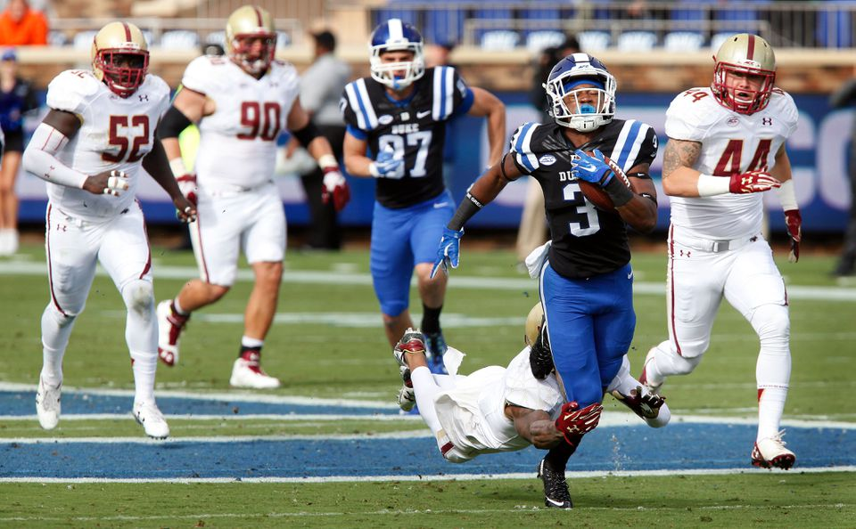 Duke wide receiver T.J. Rahming leaves some BC defenders behind after making a catch.