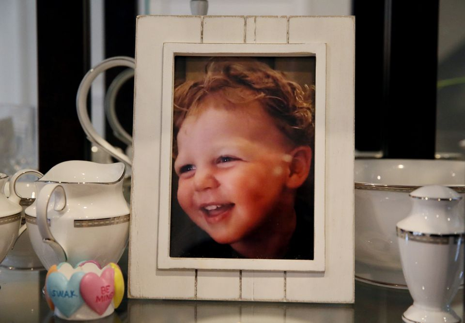 Kerri and Brendan McGrath display a picture of their son Colin at their home in South Boston.