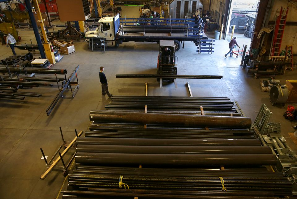 Lengths of raw pipe are off-loaded and prepared for manufacturing at the Cannistraro fabrication facility in Wilmington.