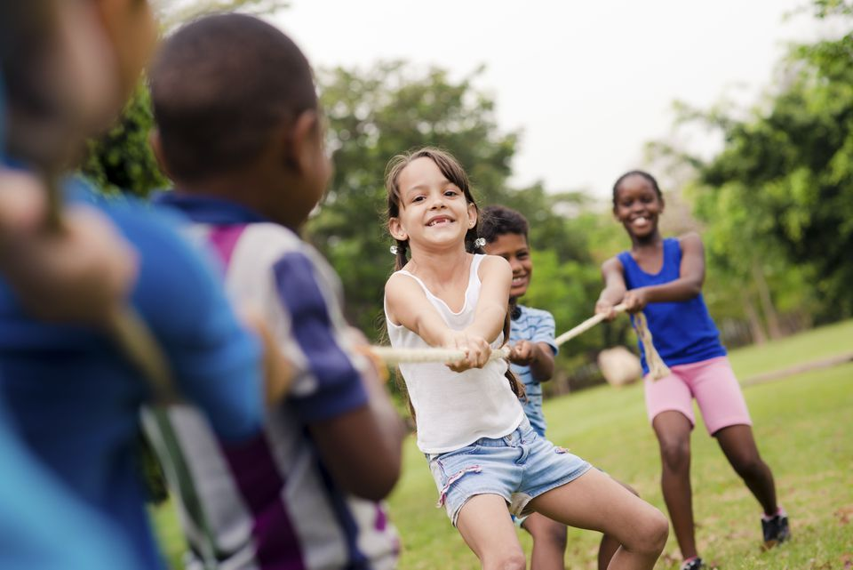 Old-school activity like tug of war helps young campers build valuable life skills and lasting memories.