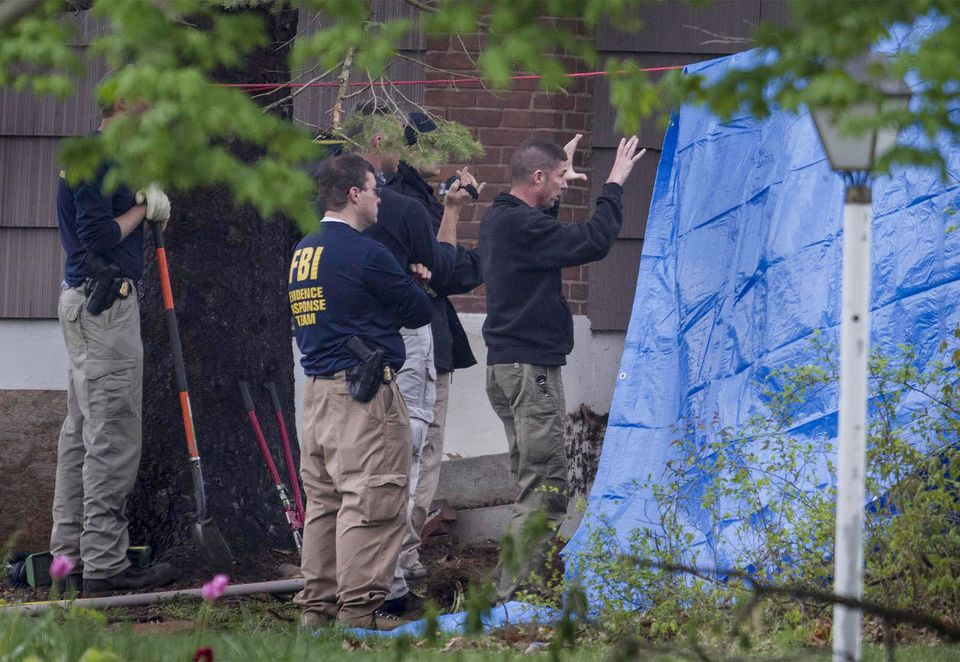 Much of the FBI search focused on an area around an underground oil tank on the property of Robert Gentile.