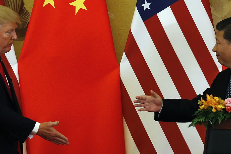 President  Trump and Chinese President Xi Jinping prepare to shake hands after a joint press conference at the Great Hall of the People in Beijing, Nov. 9, 2017.