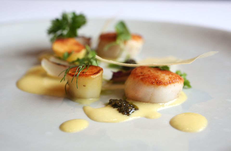 Georges Bank scallops with native sweet corn juice, hay roasted potato, and Siberian caviar at L'Espalier.