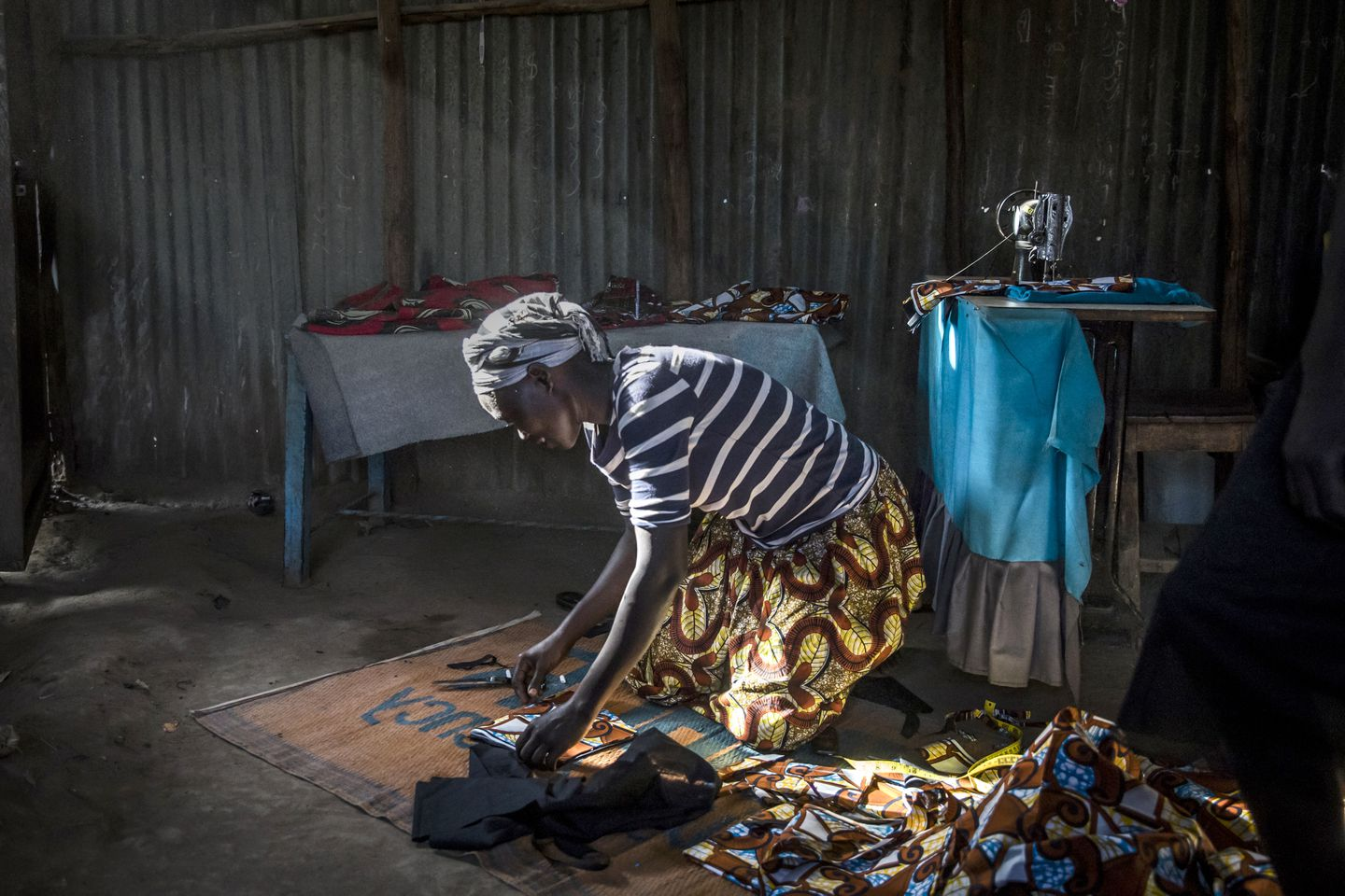 Achayo Loum, a student of Southern New Hampshire University's online degree program for refugees, worked on a dress in the UNHCR refugee camp in Kakuma.