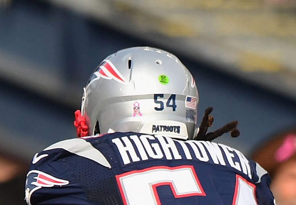 The green dot on the helmet — in this case Dont'a Hightower's — indicates the player authorized to communicate electronically with the sideline.