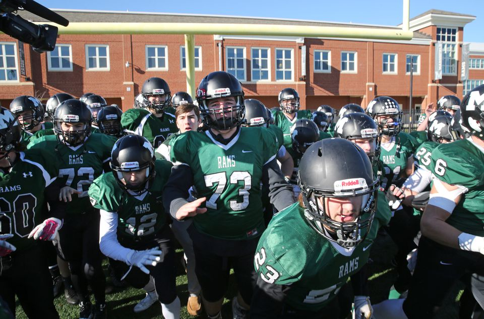 Marshfield players were pumped up for Lou Silva's finale as coach of the Rams.