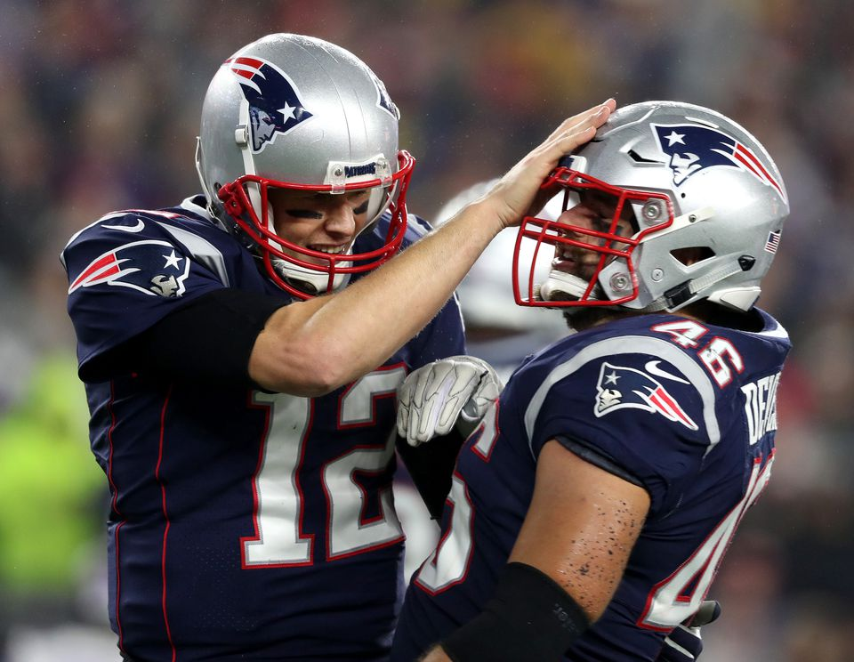 Tom Brady (left) congratulated fullback James Develin on one of his two touchdowns.