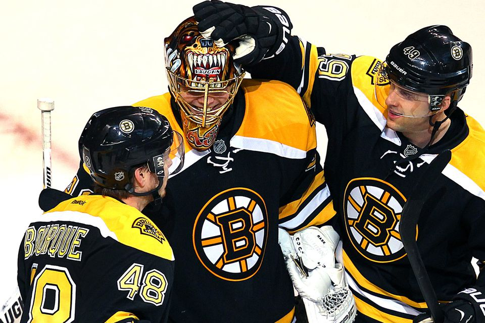 Chris Bourque (left) and Rich Peverley give Tuukka Rask props after his 20-save effort propelled the Bruins to a season-opening win.