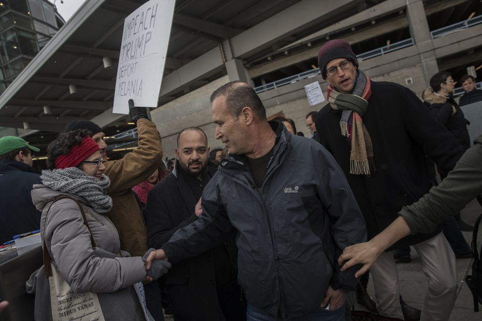 Hameed Khalid Darweesh (center), a former interpreter for the US military in Iraq, greeted a supporter after his release from detention at John F. Kennedy International Airport in New York Saturday.