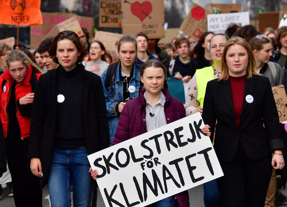 Sixteen-year-old Swedish climate activist Greta Thunberg (center) takes part in a march for the environment and the climate, organized by students, in Brussels, on Feb. 21.