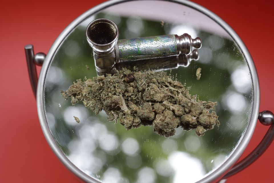 Marijuana and a pipe used to smoke it are displayed on a mirror, in New York.