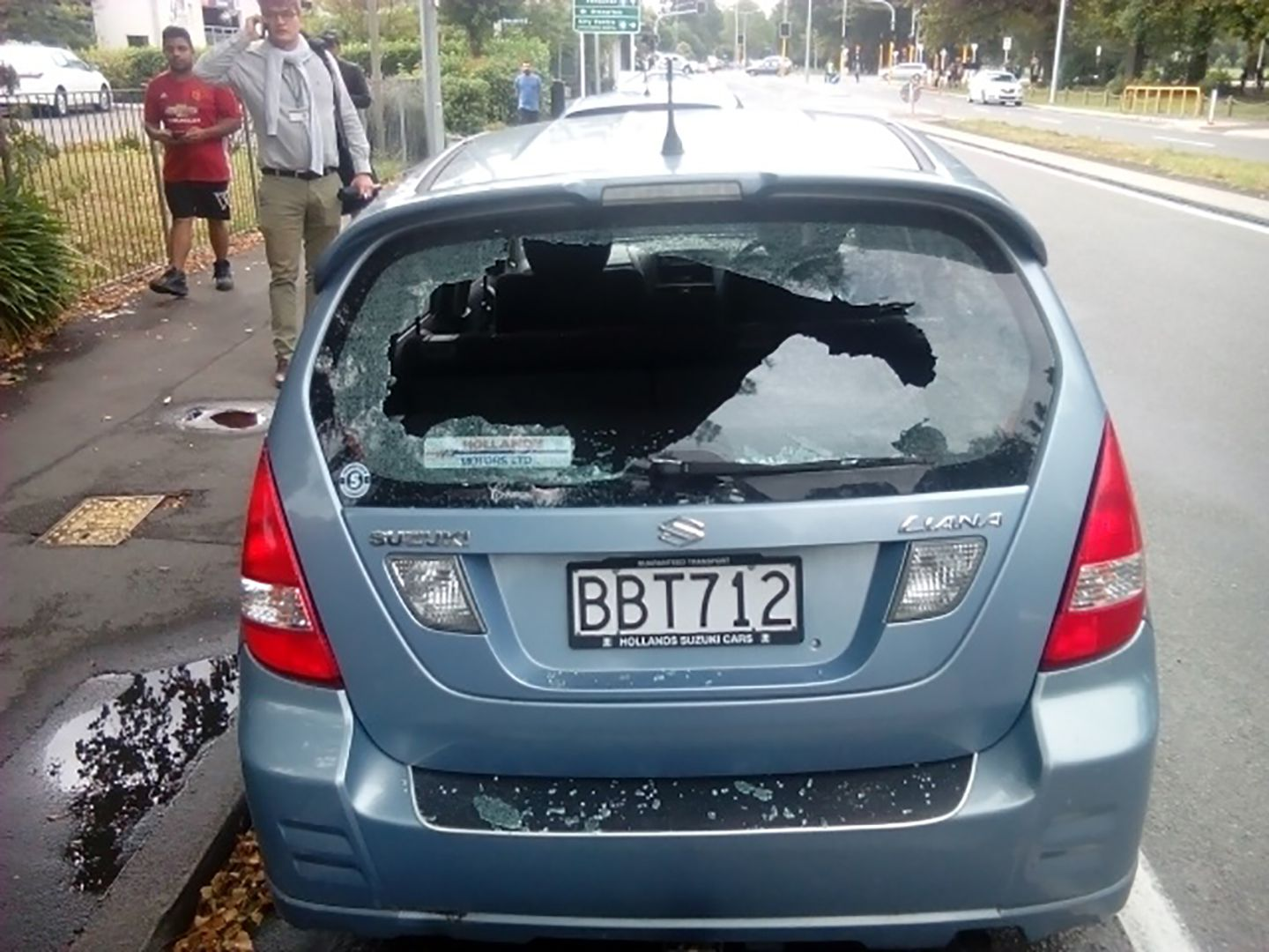 A car with shattered windows near the mosque in Christchurch.