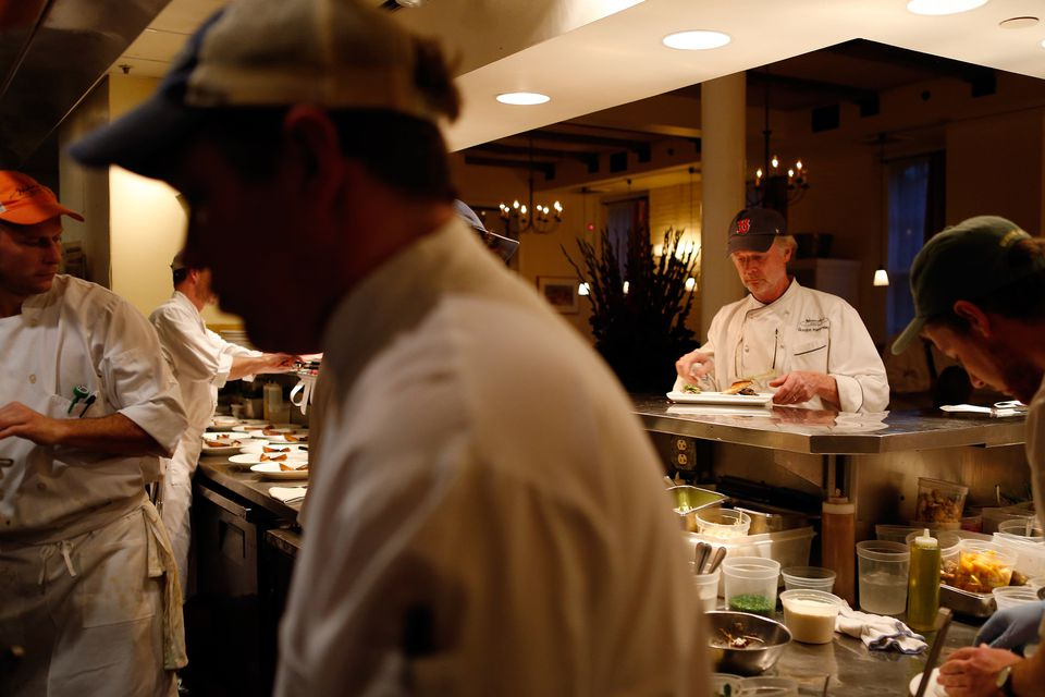Chef Gordon Hamersley, right, oversaw a plate of food on the last night of regular service at Hamersley's Bistro Monday.