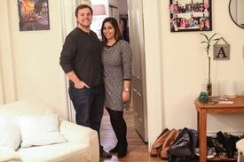 Shayna Chapel (right) and Aaron Cotton in their apartment in the Back Bay .