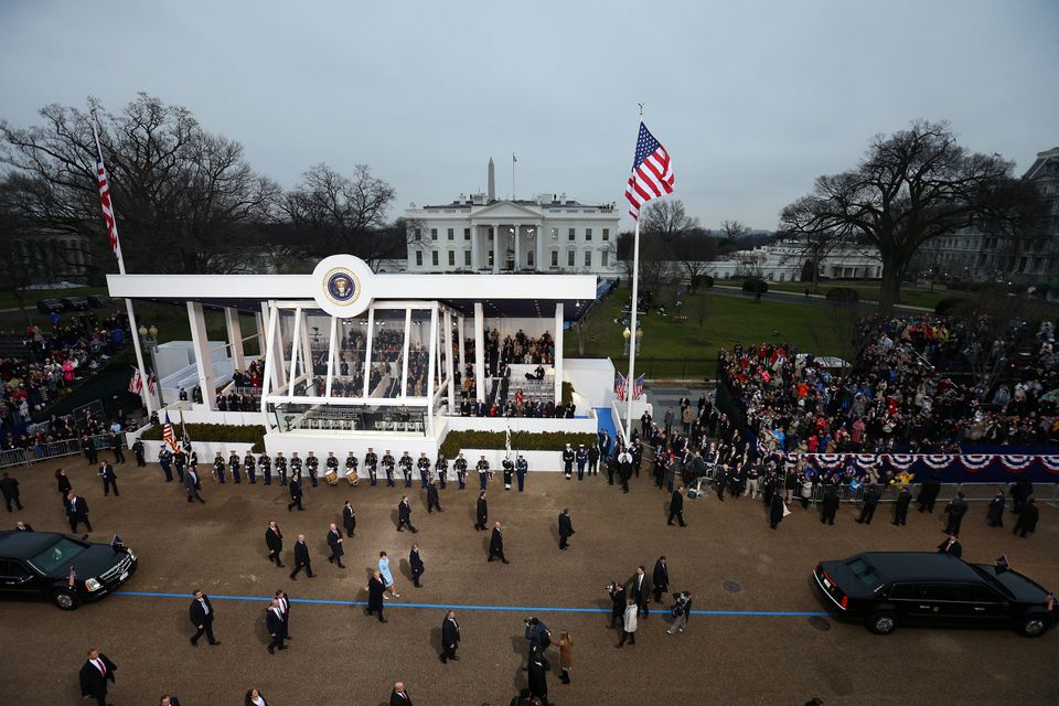 President Donald Trump waved to supporters as he walked the inaugural parade route past the main reviewing stand in front of the White House.
