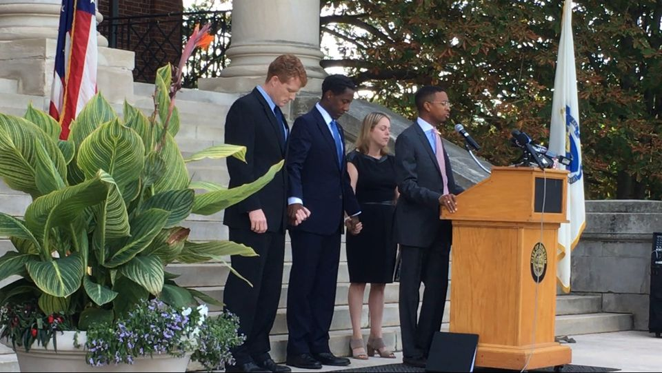 From left, Congressman Joseph Kennedy III, Newton Mayor Setti Warren, Rabbi Allison Berry of Temple Shalom, and the Rev. Brandon Thomas Crowley of Myrtle Baptist Church held hands on the steps of Newton City Hall as Crowley gave the opening prayer Thursday.