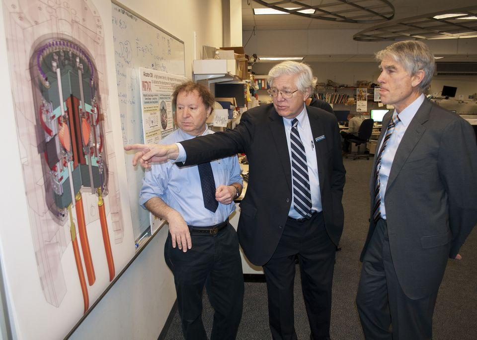 Reinier Beeuwkes (center) discussed a diagram of the Alcator C-Mod reactor during a tour at MIT with Senator Mark Udall of Colorado (right) and Martin Greenwald, associate director of the fusion center.