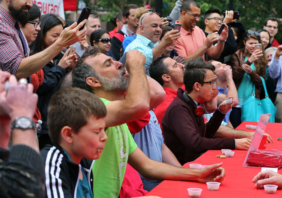Contestants had to swallow two cups of roasted crickets in the cricket eating competition.