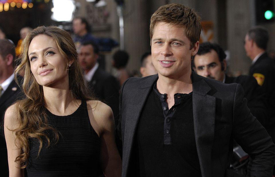 "Brad Pitt and Angelina Jolie arrive at the premier of ""Ocean's Thirteen."""