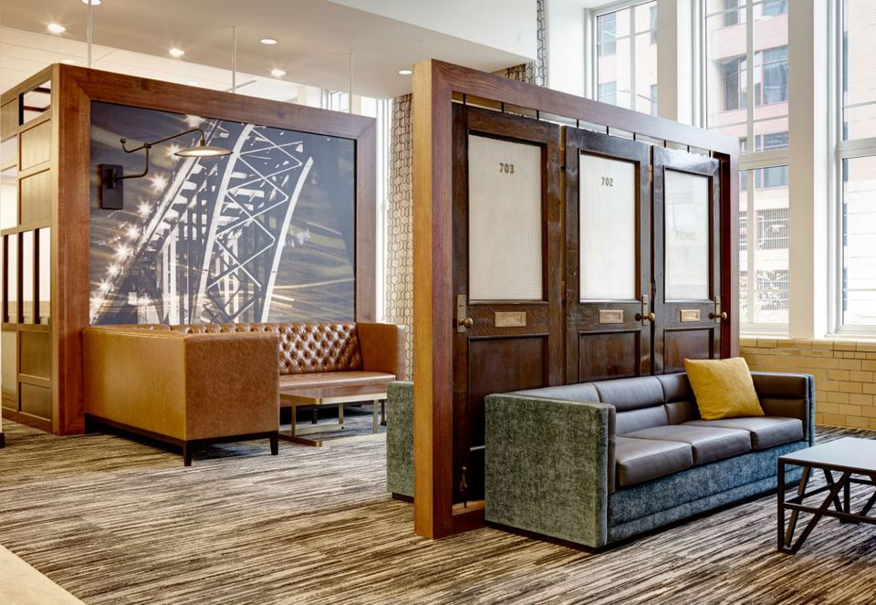 Original doors from the 17-story building's early incarnation as the Eugene McCarthy Post Office have been reused in ornamental ways at Hyatt Place St. Paul/Downtown.