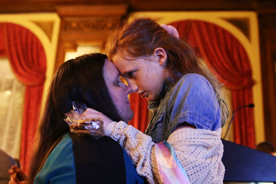 A woman and her daughter, who is transgender, celebrated after Massachusetts voters backed transgender rights.
