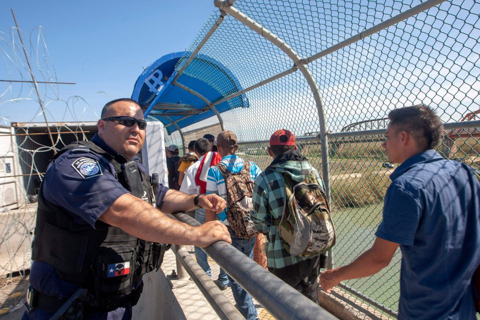 Central American migrants seeking asylum crossed a bridge in Piedras Negras, Mexico to be interviewed by US authorities in February.