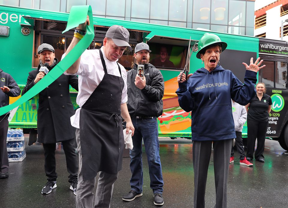 From left: Donnie, Paul, Bob, and Alma Wahlberg unveil the new Wahlburgers food truck at the South Bay Center.