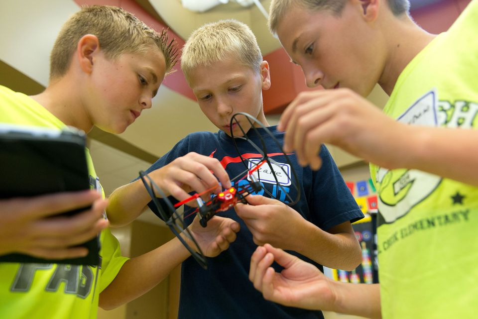 Pupils took a moment to make some minor repairs after their drone tumbled to the floor.