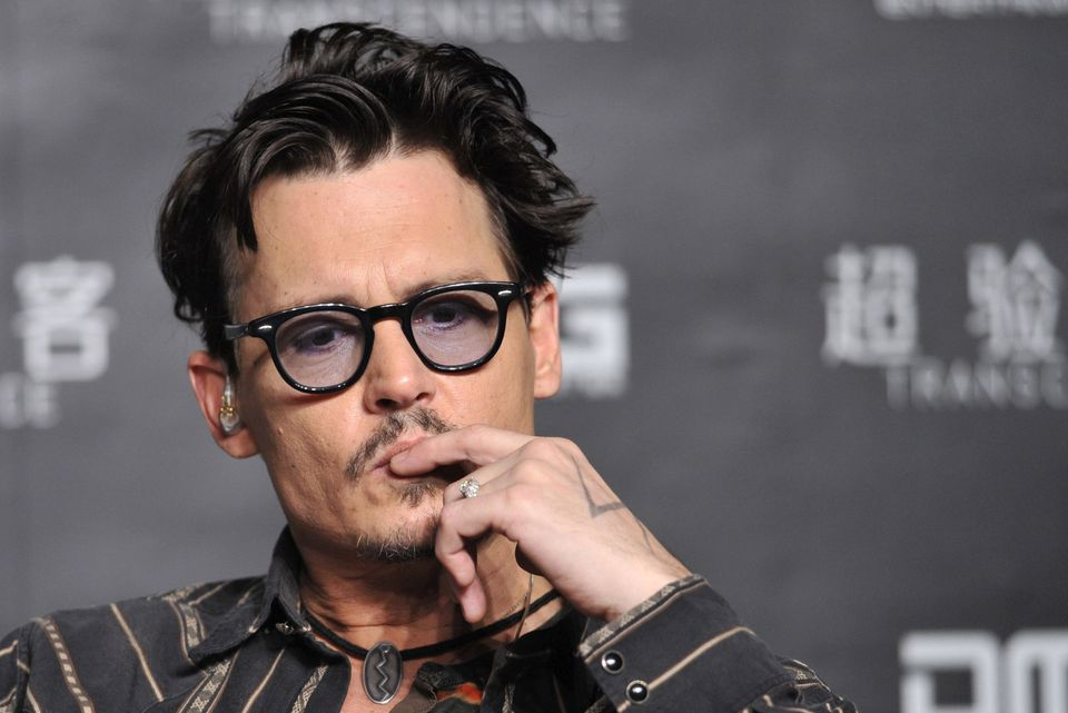 """Actor Johnny Depp attended a promotional event in China for his movie """"Transcendence"""" in March."""