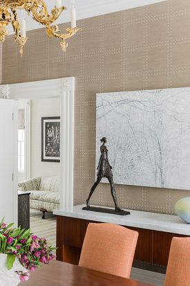A textured wallpaper was used in a Jamaica Pond dining room.