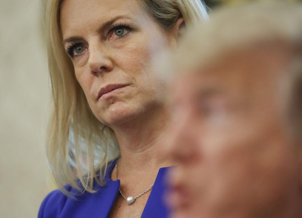 Homeland Security Secretary Kirstjen Nielsen listened to President Trump at the White House Wednesday.