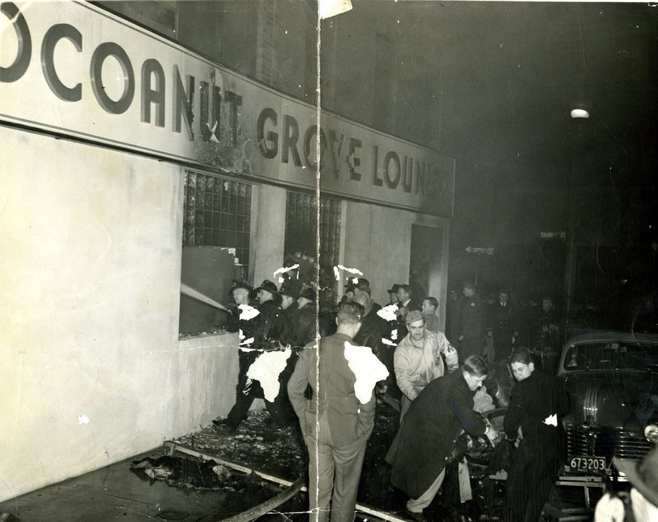 Firemen streamed water into the Cocoanut Grove Lounge through the windows.