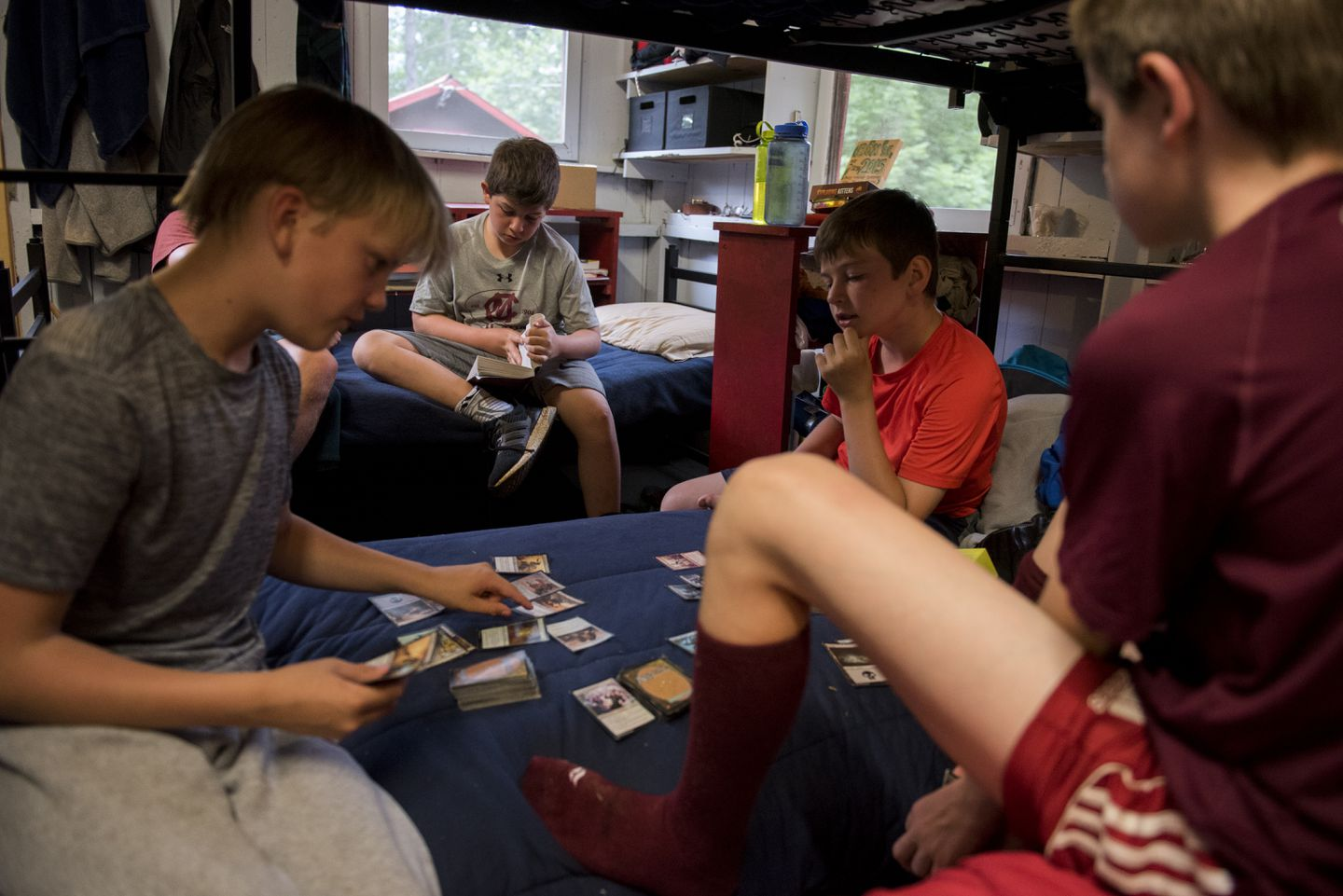 "Carson Krulewitch, center back, read ""The Mark of Athena"" while his fellow campers played Magic the Gathering at Camp Moosilauke."