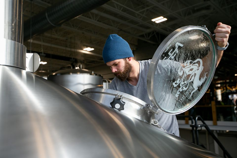 Mike Webster, brewer at Tree House Brewing company, added salt to a mash in one of the mash tuns at the brewery in Charlton.