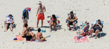 Photos show Christie lounging at N J  state beach closed due